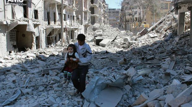 A man and girl amid the rubble of houses destroyed in 2014 by Syrian government air strikes in the city of Aleppo. Every ...