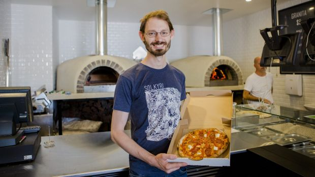 """Happy customer Dax Liniere of Gold Creek with one a customised pizzas from 10"""" Custom Pizzeria."""