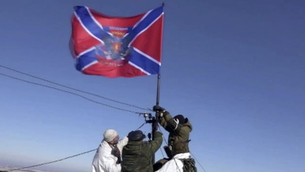 "In this image from Russian Television Channel 1, separatists hoist their ""New Russia"" flag over  Debaltseve in eastern ..."