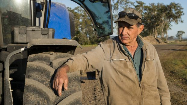 Tony Bugeja with his tractor, on his sugar cane farm, Mackay, North Queensland.