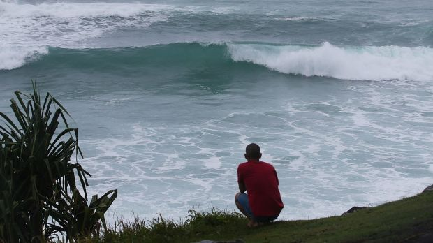 A man watches the waves at Burleigh Heads.