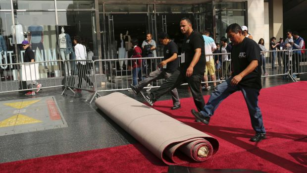 Workers roll the red carpet outside the Dolby Theatre at last year's awards.