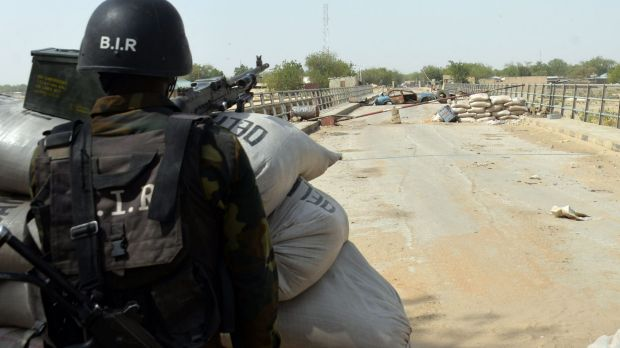 A Cameroonian soldier stands guard.  Boko Haram insurgents have suffered a string of defeats in a military offensive by ...