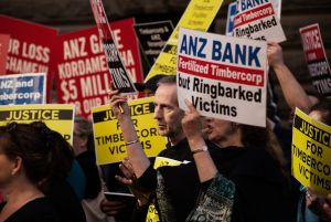 Protesters gather outside a 2014 Senate inquiry into the collapse of Timbercorp.