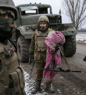 A Ukrainian serviceman retreating from Debaltseve carries his bedding near Artemivsk.