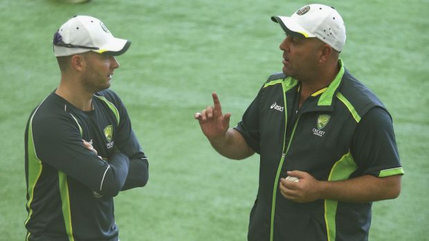 Stuck indoors: Michael Clarke and Darren Lehmann speak during the Australian nets session at the National Cricket Centre ...