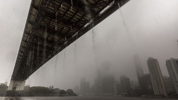 Rainwater flows off of the Storey Bridge and into the Brisbane River.