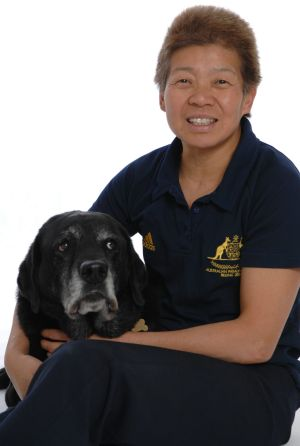 Paralympic medalist Lindy Hou with her guide dog Harper.