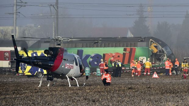 Rescue workers inspect the site of a train crash.