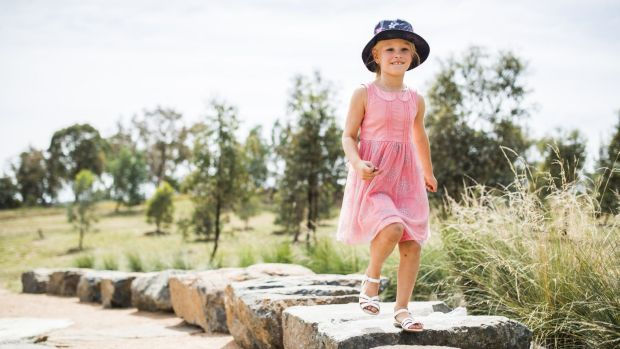 Elizabeth Latimore, 5, from Giralang, in the new Forrest20 space. The Clearing is a small rock amphitheatre built by ...