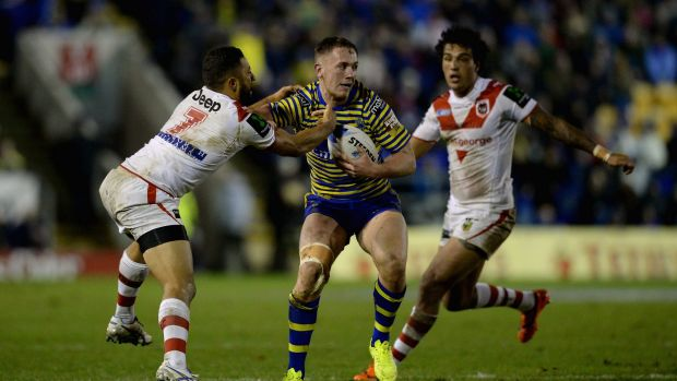 Marshall lore: Benji Marshall, left, tackles Warrington's Ben Currie.  The former Tiger scored two tries in the World ...