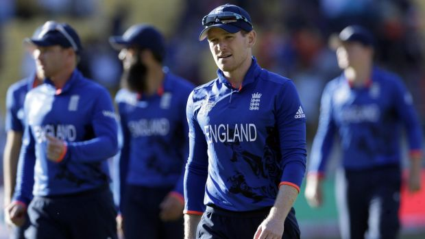 Fiasco: England captain Eoin Morgan leads his team off the field after they were annihilated by New Zealand.