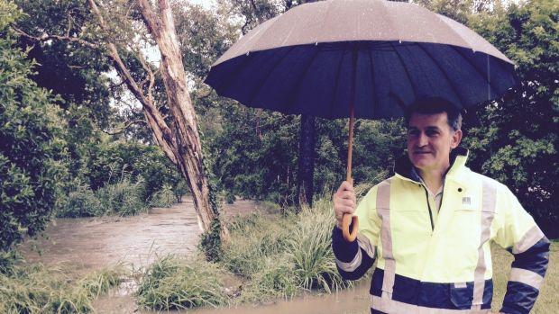 Brisbane Lord Mayor Graham Quirk surveys potential flood waters at Mimosa Creek inSunnybank.