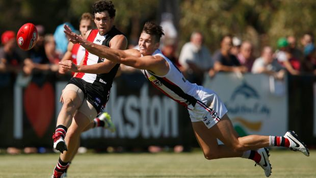 Paddy McCartin kicks as Dylan Roberton attepts to smother during a St Kilda intra-club match on Saturday.