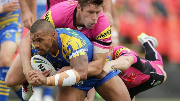 Handful:  Manu Ma'u is tackled during a full blooded trial match between the Panthers and Eels.
