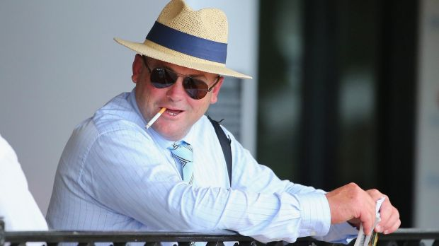 Trainer Peter Moody looks on during Saturday's races at Flemington.