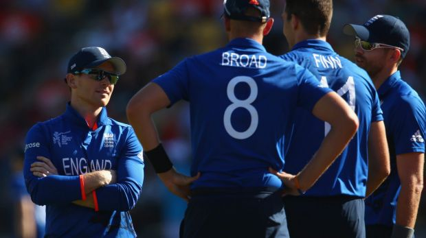 All talk, little action:  England captain Eoin Morgan speaks to his bowlers Stuart Broad, Steven Finn and James Anderson ...