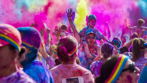 Todd and Logan Berry, 6, in the action from the Colour Run in Canberra.