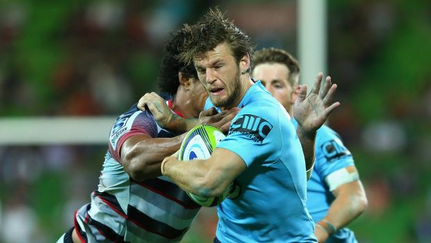 Chasing their best: Rob Horne of the Waratahs is tackled during the win over the Rebels last month.