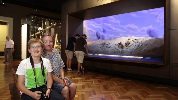 Aedan, 12, of Sydney, with his father James MacNamara at the Australian War Memorial after the official opening.