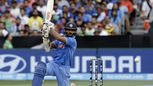 Shikhar Dhawan goes down on one knee to drive through the covers.