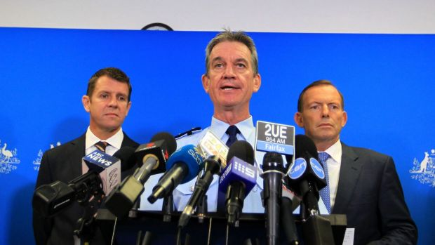 NSW Police Commissioner Andrew Scipione (centre), flanked by NSW Premier Mike Baird and Prime Minister Tony Abbott, has ...