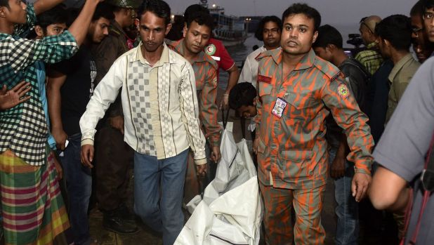 Rescue workers at the scene of Bangladesh's latest ferry disaster on Sunday.