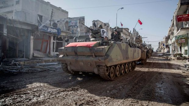 Turkish tanks return to the northern Syrian town of Kobane after their operation inside Syria on Sunday.