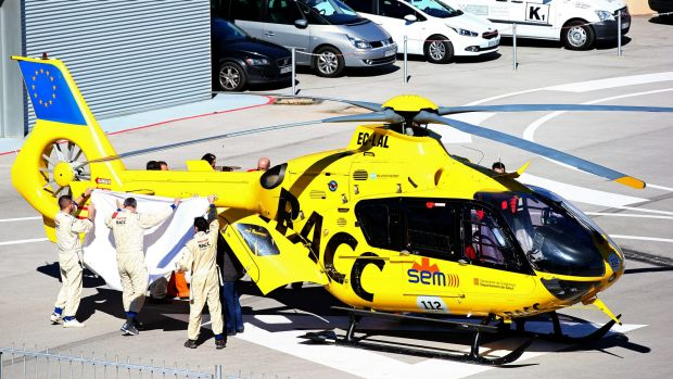 Serious accident: Fernando Alonso of McLaren Honda is transferred from the medical centre to the helicopter after ...
