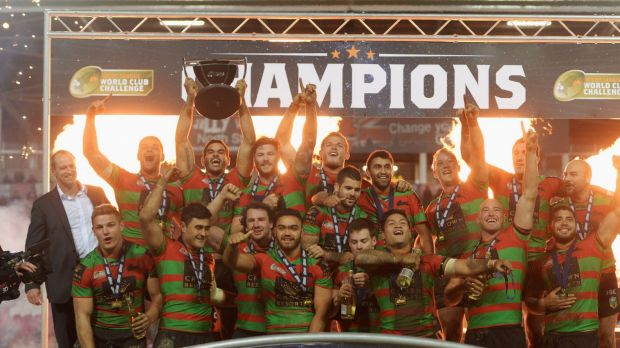 Champions: Captain Greg Inglis lifts the trophy in celebration after the South Sydney Rabbitohs beat St Helens to win ...