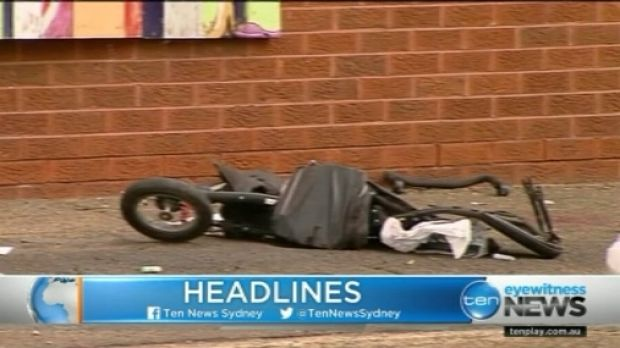 A child's pram lies wrecked after the accident on Canterbury Road, Belmore.