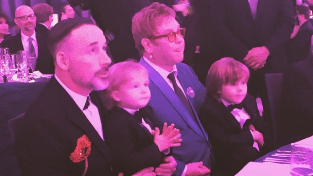 Happy family: Elton John and David Furnish with their two sons at the Elton John AIDS Foundation Oscars Viewing Party.
