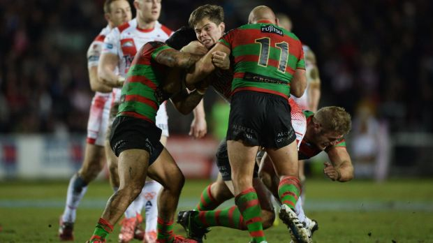 Wrapped up: Louie McCarthy-Scarsbrook is tackled by Glenn Stewart, Issac Luke and Tom Burgess during South Sydney's 39-0 ...