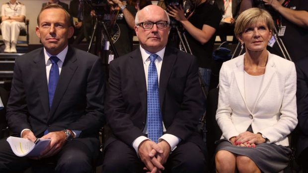 Foreign Minister Julie Bishop, pictured with Tony Abbott and George Brandis, says the Prime Minister's comments linking ...