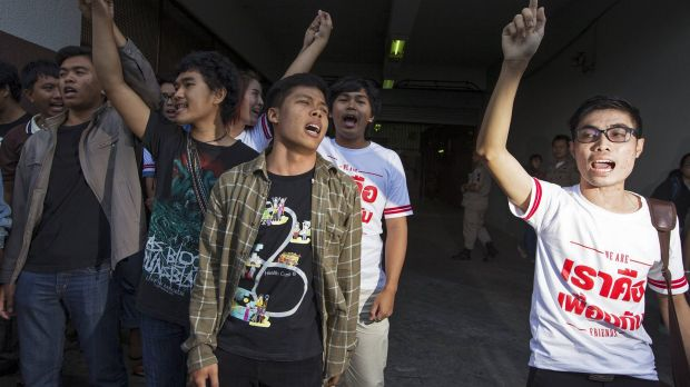 Friends of Patiwat Saraiyaem and Porntip Mankong react after the two were sentenced.