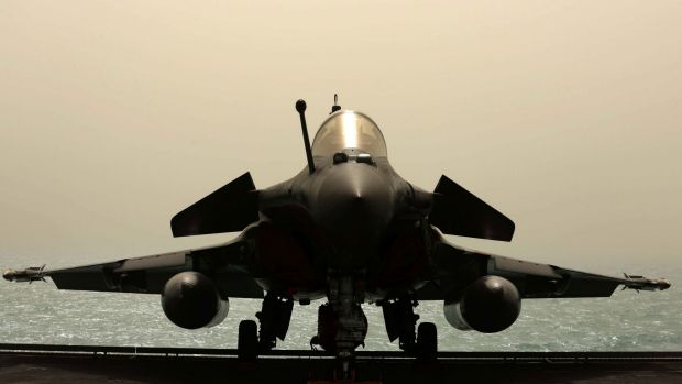 A French Navy Rafale fighter jet sits on the deck of the aircraft carrier Charles de Gaulle.