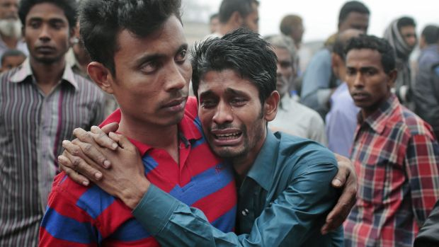 Bangladeshi people cry as rescuers search the River Padma after the ferry accident.