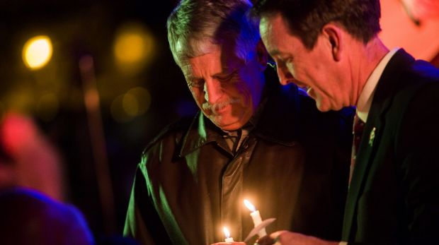 Critical of US ransom policy ... Carl Mueller holds his candle during a candlelight memorial honouring his daughter aid ...