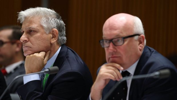 Attorney-General's Department secretary Chris Moraitis (left) with his minister, George Brandis, in Senate estimates in ...