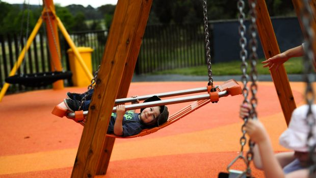 Owen  Smith, 2, enjoys the swing at Boundless Canberra playground.