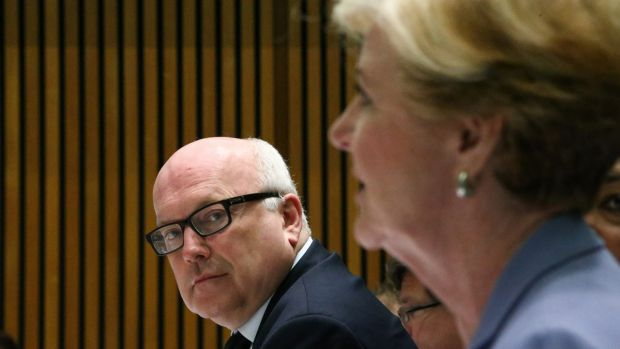 Attorney-General George Brandis and Australian Human Rights Commission president Professor Gillian Triggs during a ...