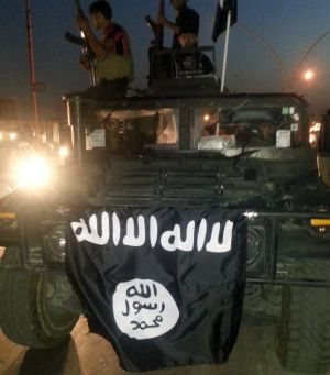 ISIL flag in Mosul, Iraq in June.