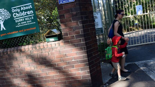 A parent leaves the childcare centre in Surry Hills where a member of staff was diagnosed with TB.