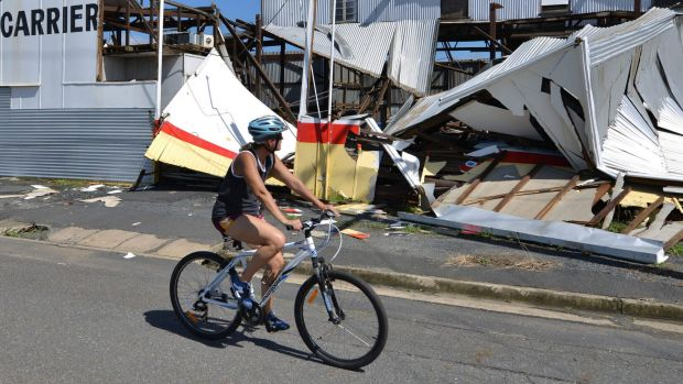 A local rides through the aftermath of Cyclone Marcia in Rockhampton.