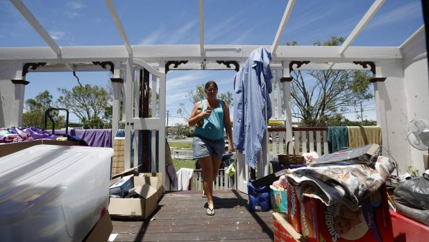 Yeppoon resident Demelza Bischoff inspects the damage to her home.