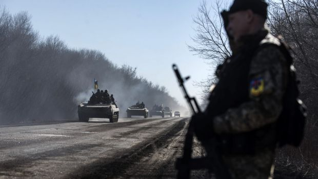 Ukrainian troops ride on armoured vehicles near Artemivsk, eastern Ukraine,