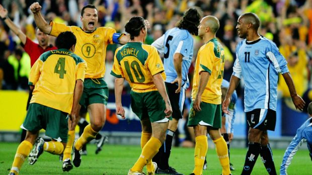 Famous victory: Mark Bresciano, second from right, celebrates scoring against Uruguay in 2005.