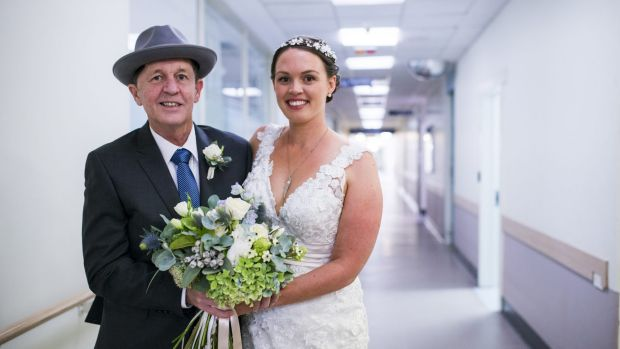 Malcolm Gibson with his daughter Kate before her wedding at the Canberra Hospital.