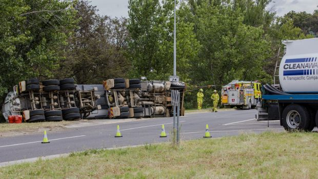 Sewage waste truck tips over on Morshead Drive on Thursday morning.  The Canberra Times  Photo Jamila Toderas