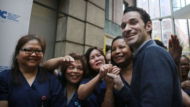Dr. Craig Spencer with some of the nurses who helped him to recovery at New York's Bellevue Hospital.